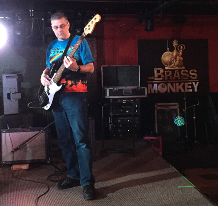 A full length view of Scott playing bass guitar at the Brass Monkey on November 30th, 2016.