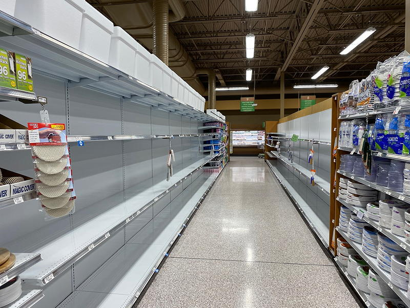 The shelves are empty of many paper products due to the COVID-19 panic hoarding.