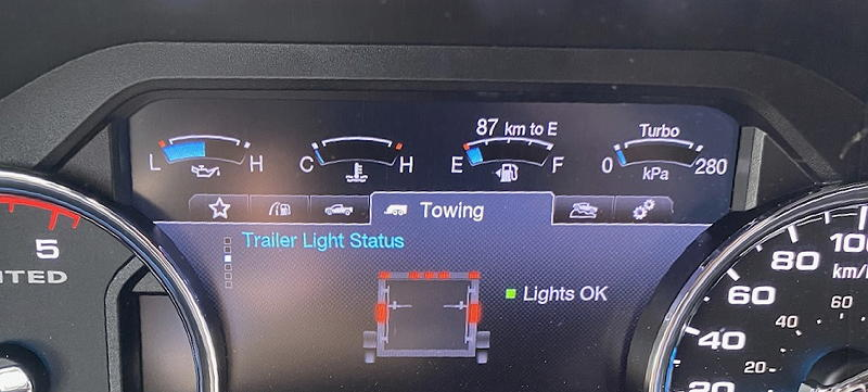 I have a routine for departure mornings which includes confirming that the trailer lights are working after a visual inspection of the four-way flashers at the back of the trailer. This confirms that all of the lights are working without checking manually. Sharp-eyed readers may notice the fuel guage. I didn't.