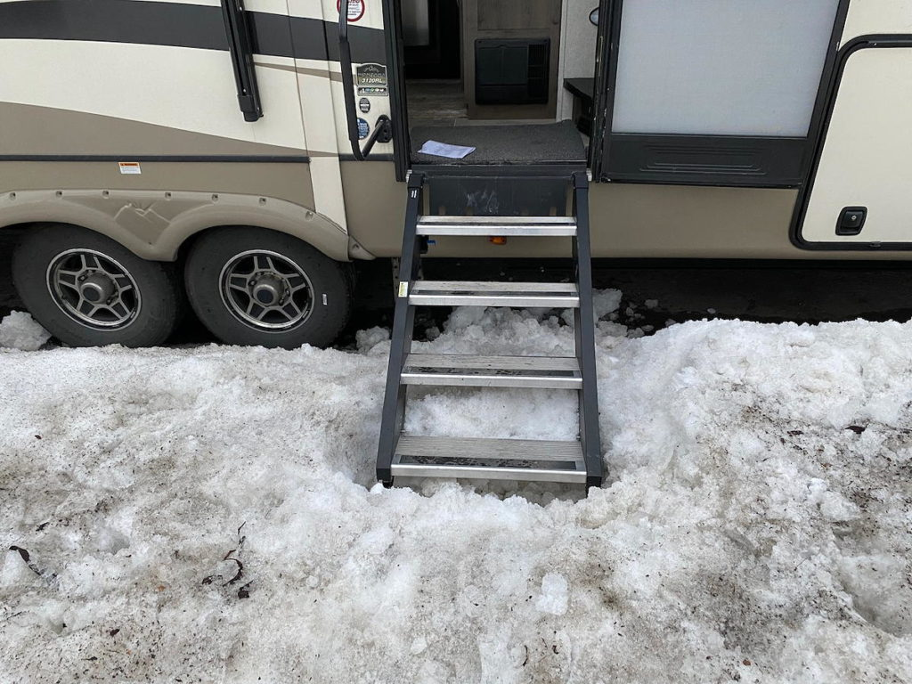 You can see how much we had to dig out the snowbank. Even so, the stairs aren't low enough to close the trailer door. Instead, the door wold hit the side of the top part of the stairs.