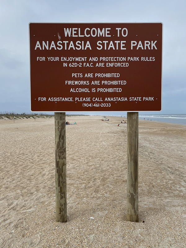 A sign welcomes us to Anastasia State Park in St. Augustine, Florida.