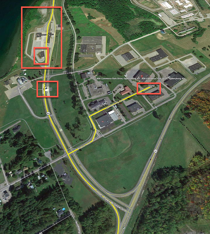 This picture shows an overview of our stops in Ogdensburg, New York. First, we stopped at the USA border guard station--it's the big cluster of buildings above the smaller red rectangle at the upper left. This time, for the first time, we were directed to the X-Ray building, marked by the smaller red rectangle inside the larger red rectangle. After that, we went through the toll booth just below. Then, we made our way to the My US Address warehouse at the right of the picture.